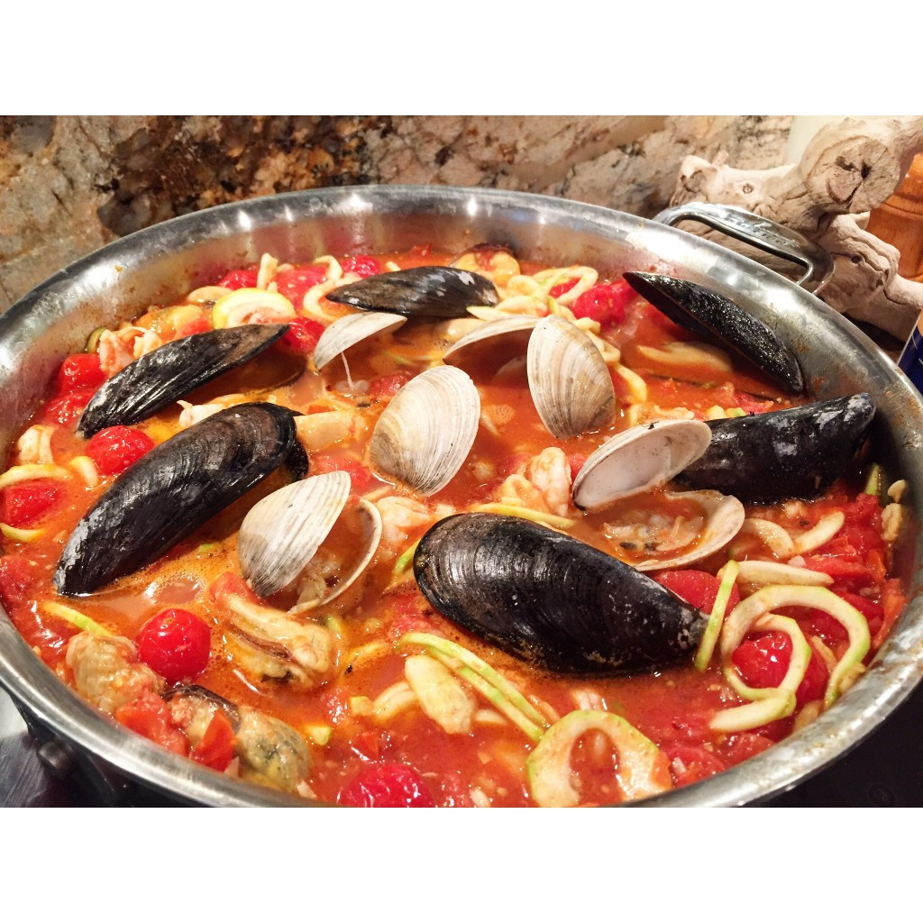 Just before serving, add the saved mussels and clams in the shell and dip the body into the sauce to heat it up, then serve.
