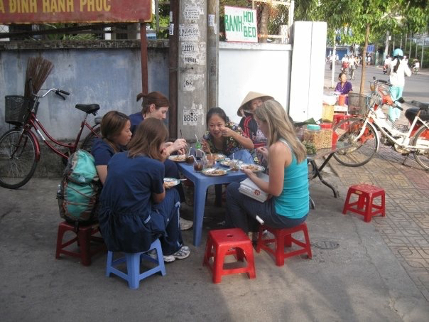 Having breakfast in true Vietnamese fashion- on a miniature plastic stool in an alley