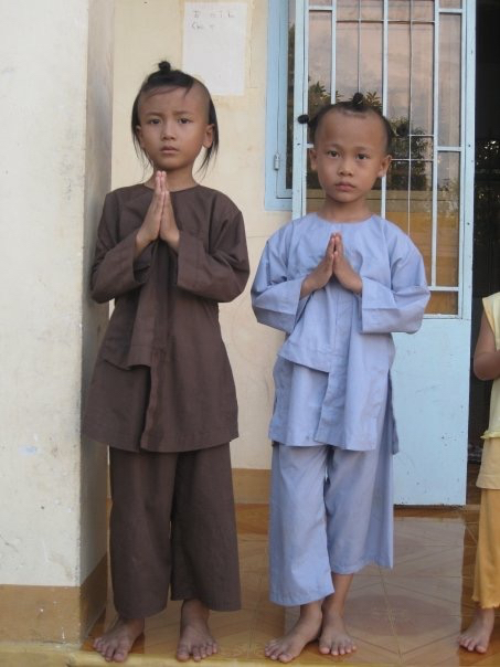 Greeted by the sweetest orphan monks at the temple.