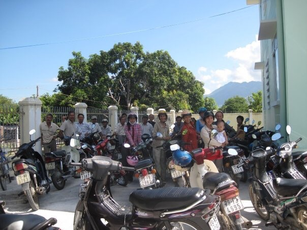 Patients lined up waiting in the hot Nha Trang summer sun. Motor bikes galore!