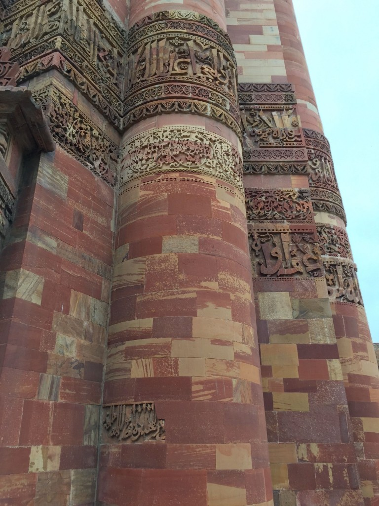Qutub Minar is a 74 meter tower made of red sandstone and marble, covered in verses from the Qur'an.