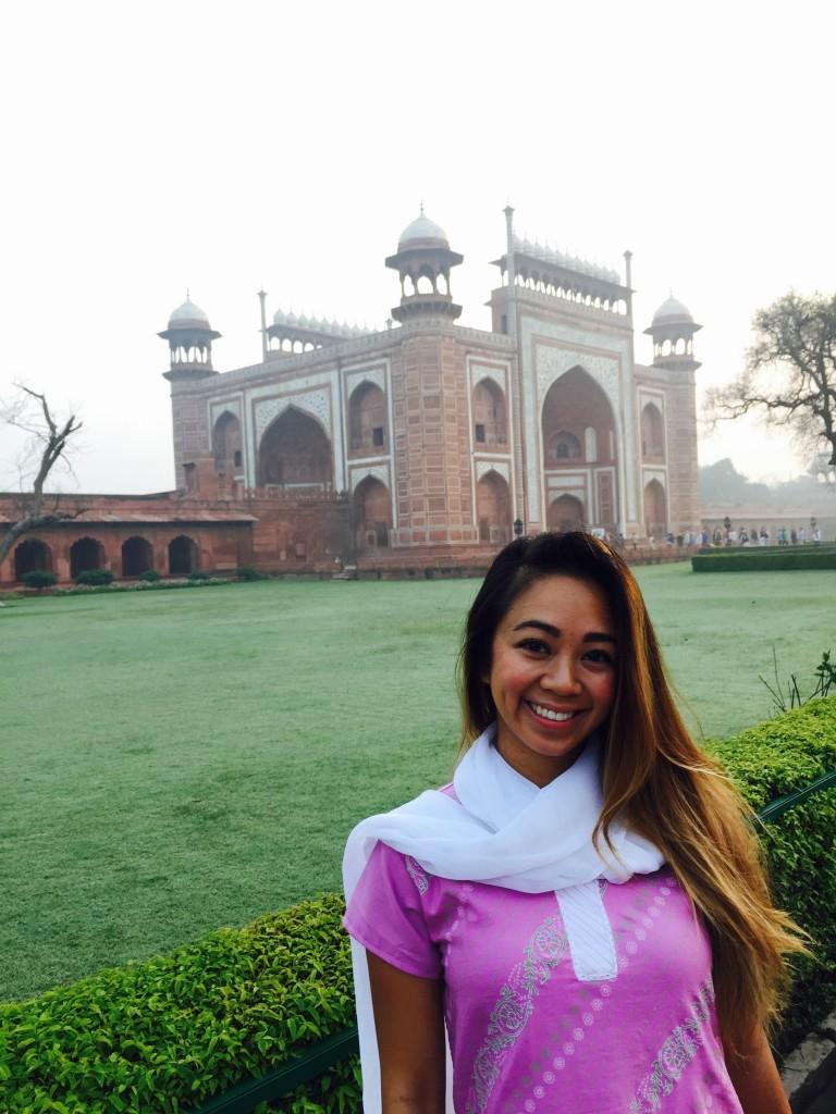 The entrance gate of the Taj Mahal in the romantic sunrise morning mist
