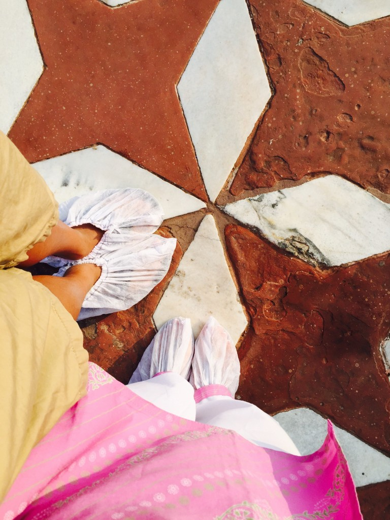 To enter inside the Taj Mahal, you must wear shoe covers even over sandals. Yes I felt like I was scrubbing into surgery!