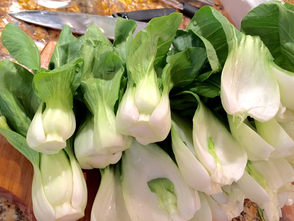Boil water with a pinch of salt. Add cleaned bok choy for 2 minutes and remove. Set aside.