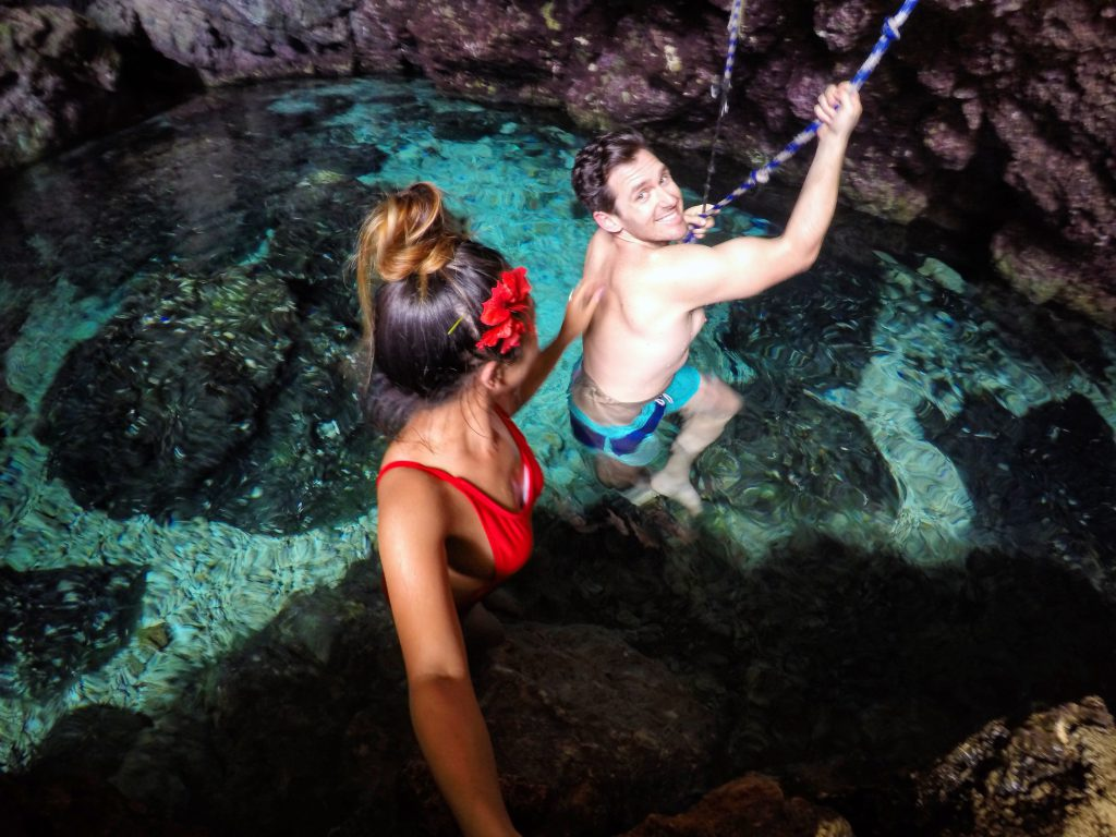 Jane and Tarzan rope swinging in a cave